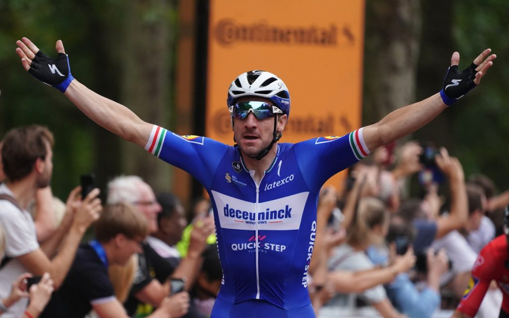 Elia Viviani (ITA) of Deceuninck-Quick-Step raises his arms in victory after sprinting to win  the Prudential RideLondon Classic.